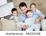 father at home reading a book... | Shutterstock . vector #98333108