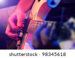 rockstar playing solo on guitar | Shutterstock . vector #98345618