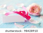 tag with ribbon and petals for mothers day - stock photo
