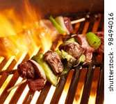 beef shish kabobs on the grill | Shutterstock . vector #98494016