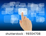 Woman hand uses virtual button on blue background with map - stock photo