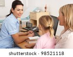 british nurse talking to young... | Shutterstock . vector #98521118