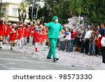 LIMASSOL, CYPRUS - MARCH 6, 2011: Unidentified participants in nurse and doctor costumes during the carnival parade, established in 16th century, influenced by Venetians. - stock photo