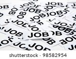 Job opportunity. Printed paper notes with the word Job in black ink - stock photo
