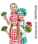 Happy chefs family preparing healthy vegetables meal - isolated - stock photo