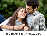 Close up portrait of attractive young couple in outdoor park. - stock photo
