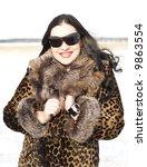 beauty fashion model in leopard coat - stock photo