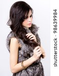 sophisticated and beautiful Latin model with fur coat - stock photo