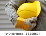 Man Holding Yellow Helmet Clos...
