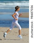 young woman jogging on the... | Shutterstock . vector #98687036