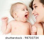 happy mother with baby | Shutterstock . vector #98703734