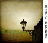 Old Street Lamp On Foggy City...