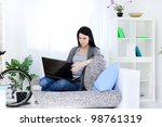 smiling woman in living room... | Shutterstock . vector #98761319