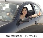 happy woman sitting in the car - stock photo