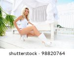 Young beautiful blonde woman in bikini posing outdoor. - stock photo