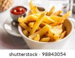 golden french fries potatoes... | Shutterstock . vector #98843054
