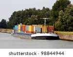 Containers in a barge near Antwerp harbor - stock photo
