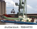 Huge mobile crane floating in Antwerp harbor and loading a ship, this crane is able to lift 800 ton. - stock photo
