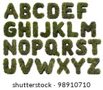 Latin alphabet letters made from grass on white - stock photo