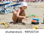 Girl in the sand - stock photo