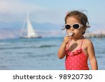 Girl with lollipop - stock photo