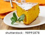 Carrot cake with powdered sugar and mint - stock photo