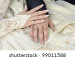 Just married couple hands. Focus on a bride hand. - stock photo