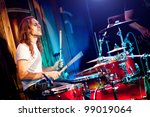 musician playing drums on a red background - stock photo