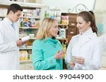 pharmacist assistance of buying medical drug to buyer in pharmacy drugstore - stock photo