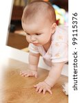 the small child plays on a floor | Shutterstock . vector #99115376