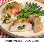 Chicken breast stuffed with cheese and green beans and wrapped in Parma ham. - stock photo