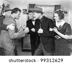 Small photo of Two men fighting with each other and being held back by a woman and a man