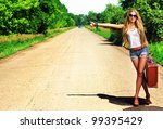 Pretty young woman hitchhiking...