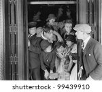 Overcrowded elevator - stock photo