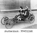 Two women in go kart - stock photo