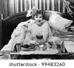 woman eating breakfast in bed | Shutterstock . vector #99483260
