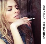 Beautiful Girl Smokes While...