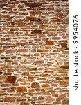 Old colorful stone wall close up background. - stock photo