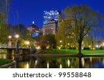 Lagoon Bridge and skyline of Boston, Massachusetts from the Boston Public Gardens. - stock photo