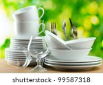 clean dishes on wooden table on ... | Shutterstock . vector #99587318