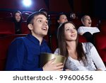 surprised people in the cinema | Shutterstock . vector #99600656