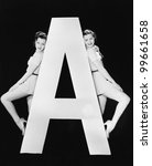 two women with huge letter a | Shutterstock . vector #99661658