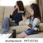 young mother talking on the... | Shutterstock . vector #99715733