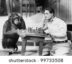 Man Playing Chess With Monkey
