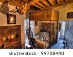 BUNRATTY, IRELAND - FEB 19: Ancient bedroom interior of 15th century Bunratty castle, traditional Irish tourist attraction of Co. Clare - Feb 19, 2012 in Bunratty Castle, Co. Clare, Ireland. - stock photo