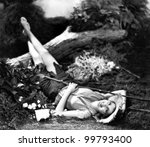 woman lying on the ground and... | Shutterstock . vector #99793400