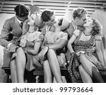 Three couples romancing and kissing - stock photo