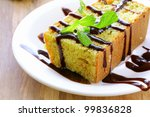piece of orange cake with chocolate sauce - stock photo