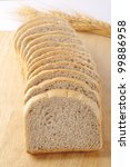 Small photo of Healthy bread slices with rolled wheat and ragi isolated on wood plank