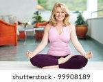 mature woman doing lotus yoga... | Shutterstock . vector #99908189